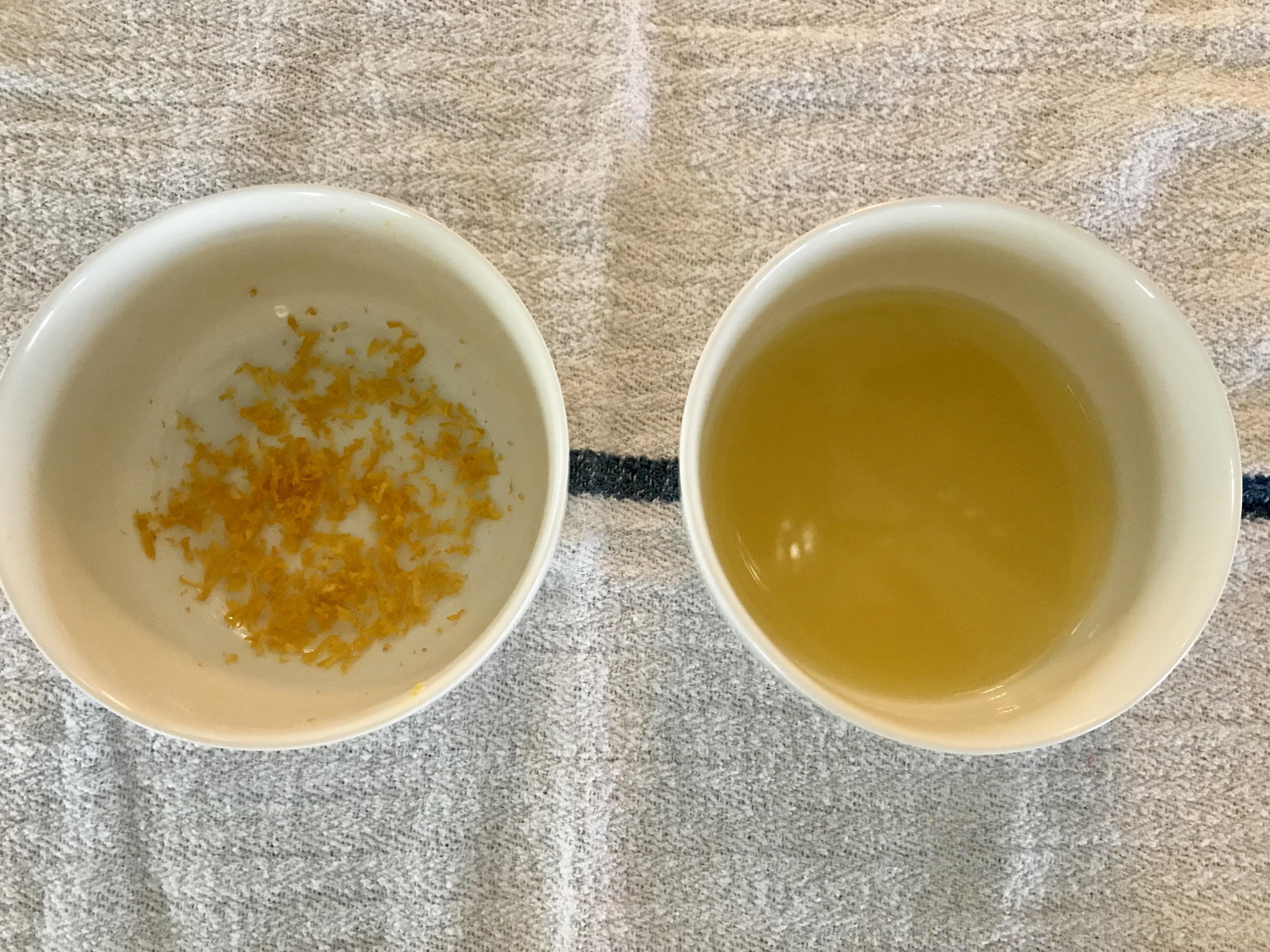 Bowls of lemon zest and freshly squeezed lemon juice