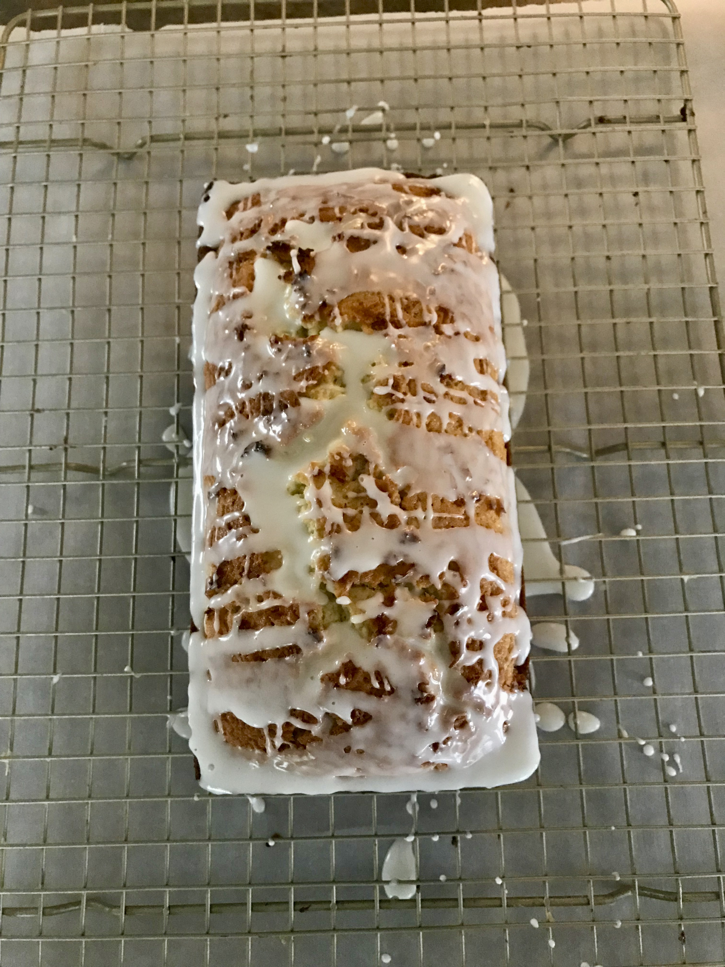 Pour glaze over Lime in the Coconut Loaf Cake