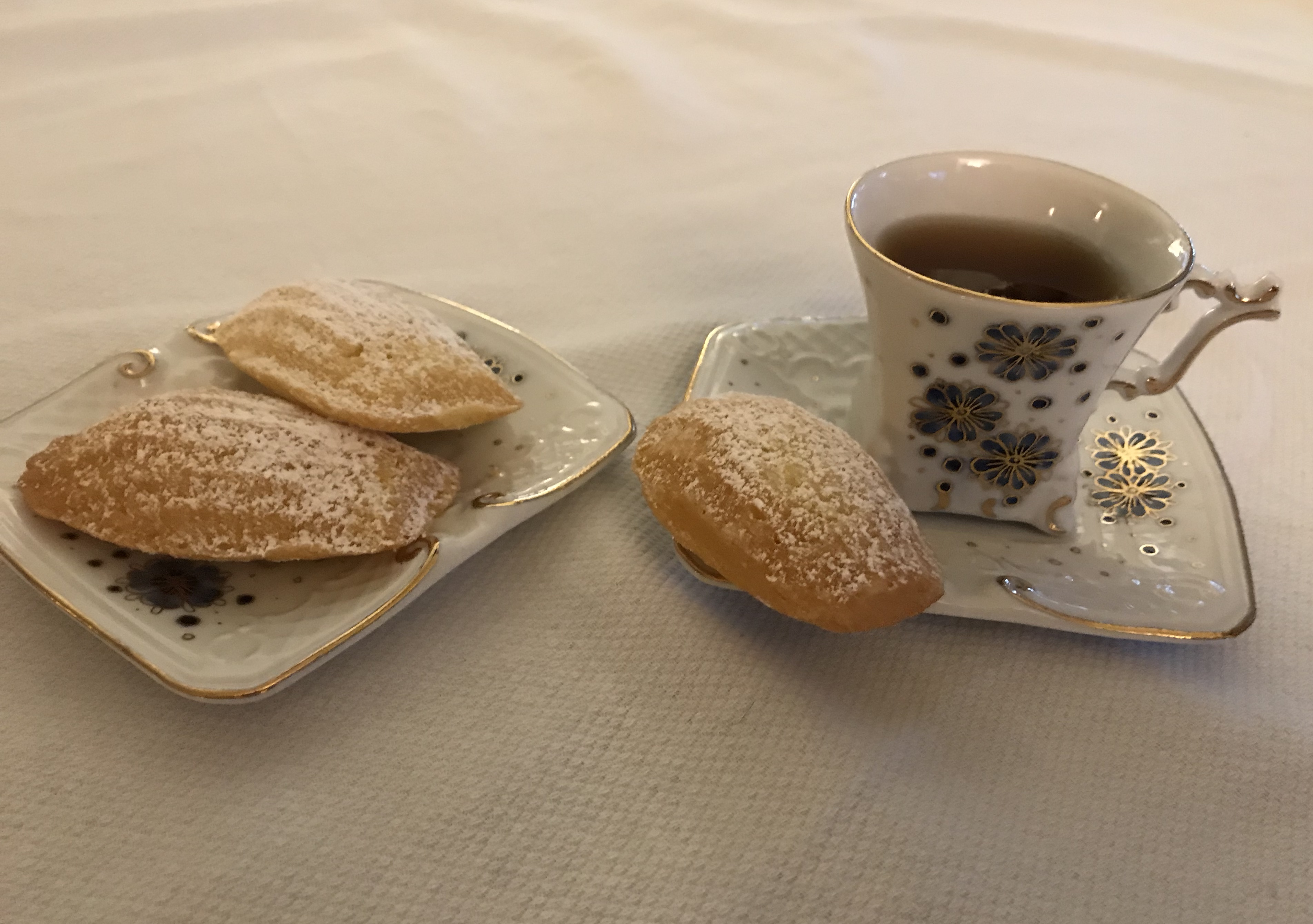 Finished Brown Butter Madeleines with a cup of tea