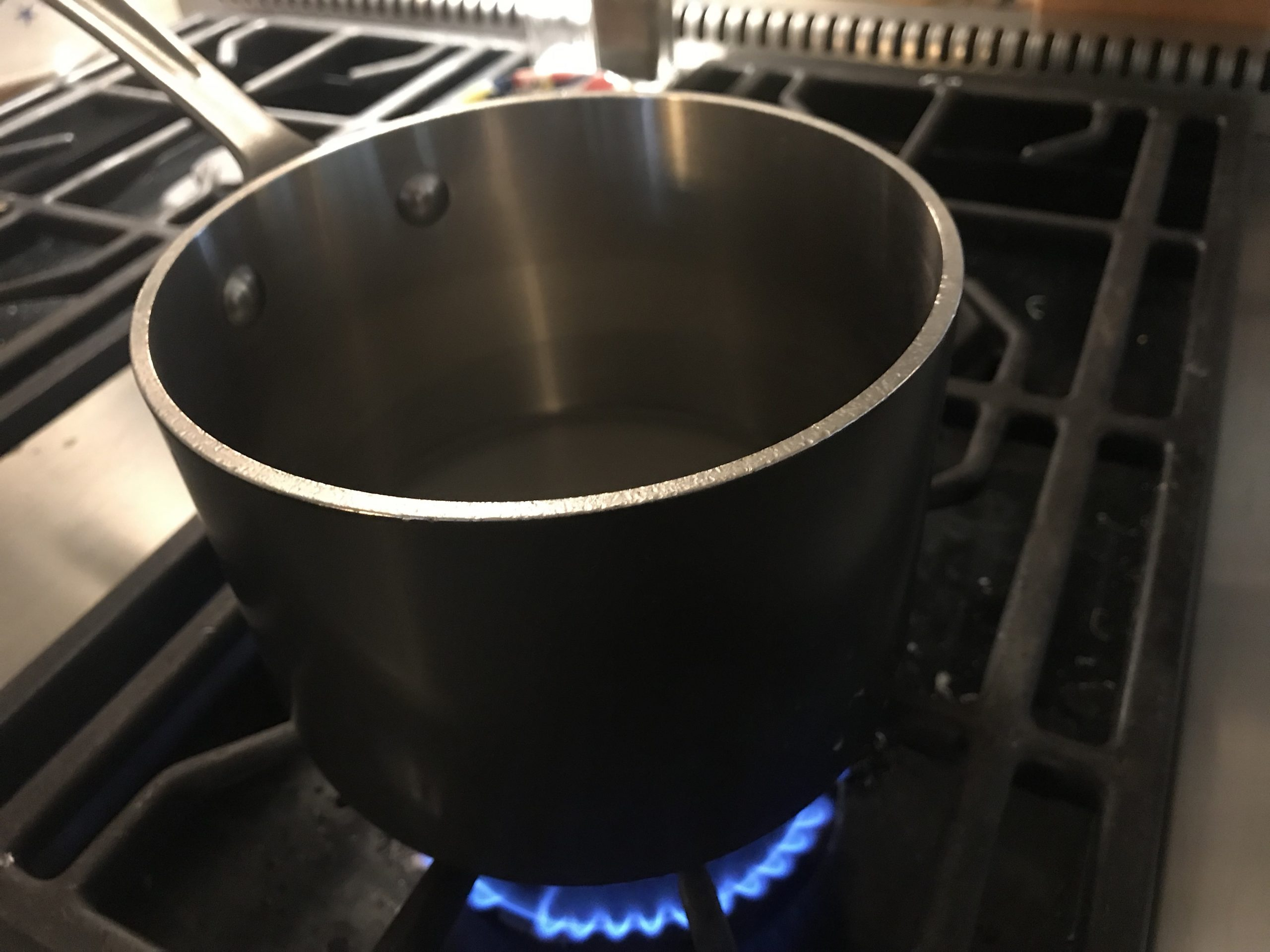 Heating water, sugar, and salt for Flourless Chocolate Cake