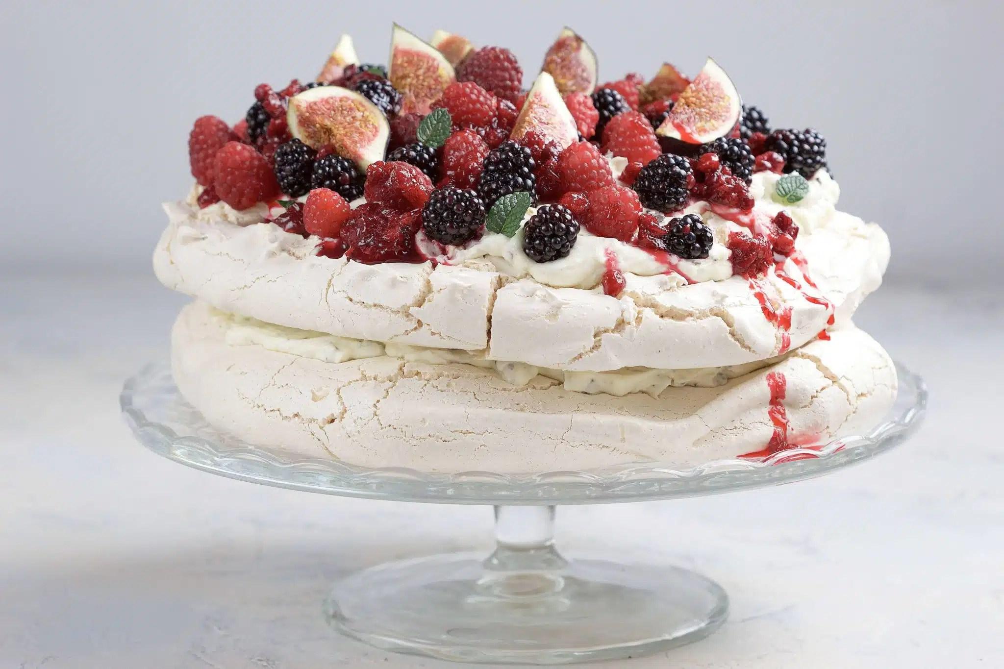 Pavlova meringue with fresh berries and stracciatella cream.