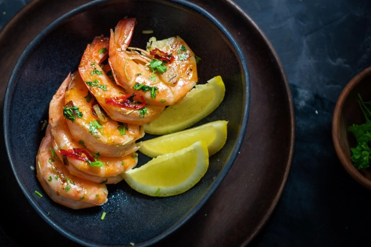 Prawns with chili, garlic a​nd parsley.