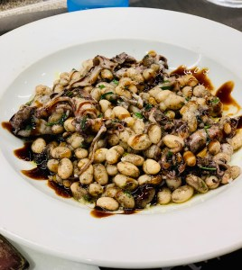 White Beans and Baby Squid at Pinotxo Bar in La Boqueria Barcelona Spain
