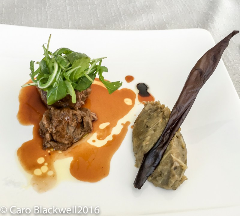 slow cooked pork cheeks served with an aubergine puree
