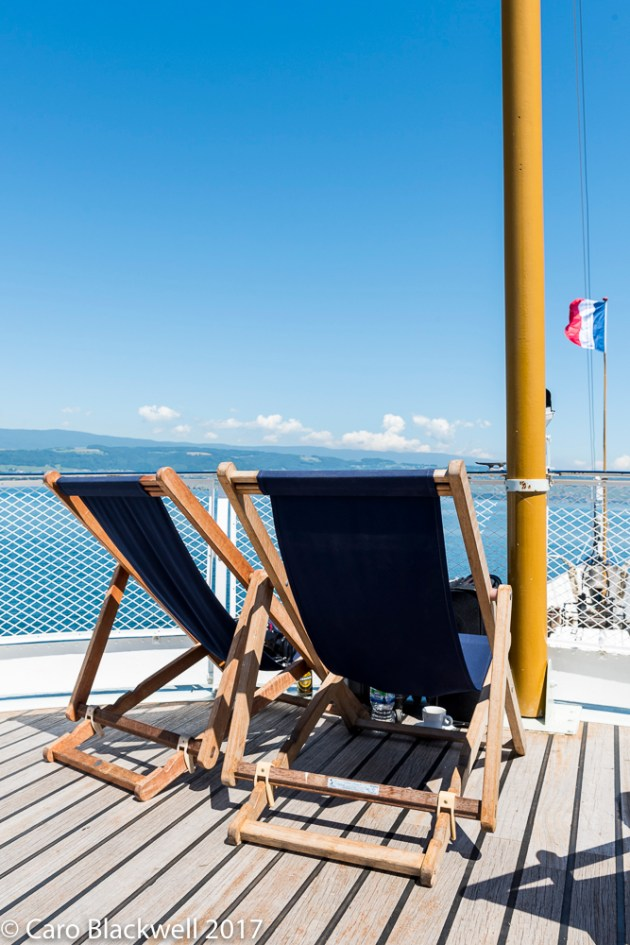 Enjoying the changing views and the deckchairs on top deck