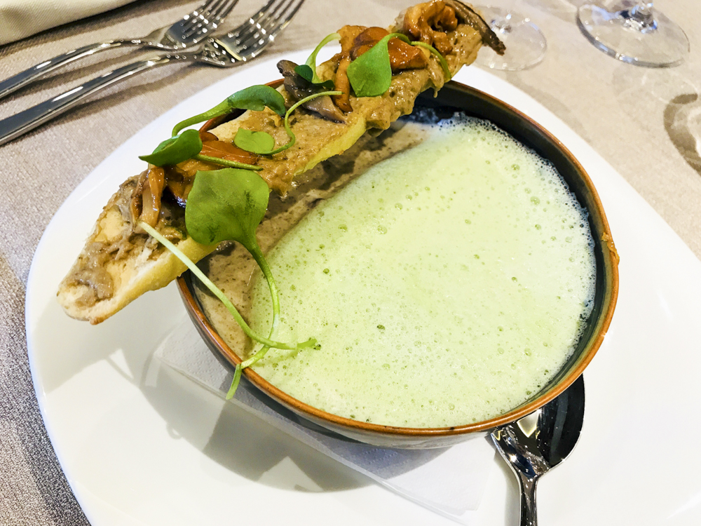 Veloute de Champignons with a parsley and garlic emulsion
