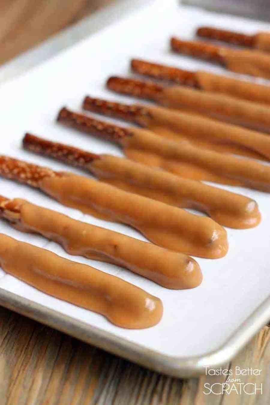 Caramel and Chocolate Dipped Pretzel Rods -TastesBetterFromScratch.com