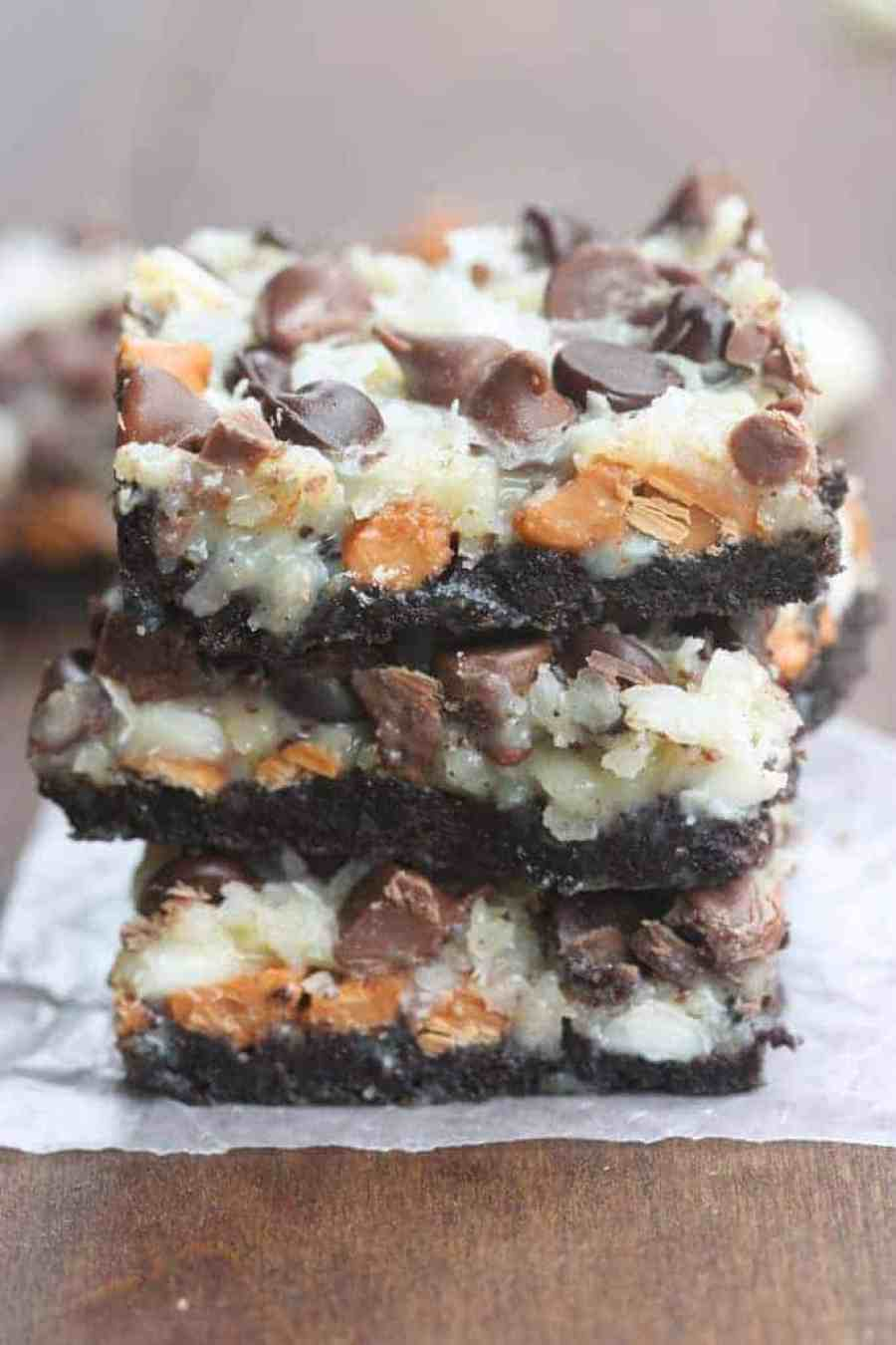 Oreo Magic Bars - Seven simple layers of Oreo chocolate bliss starting with an Oreo crust, three different types of chocolate chips, coconut and nuts. This is the EASIEST dessert, and always a party favorite.   Tastes Better From Scratch