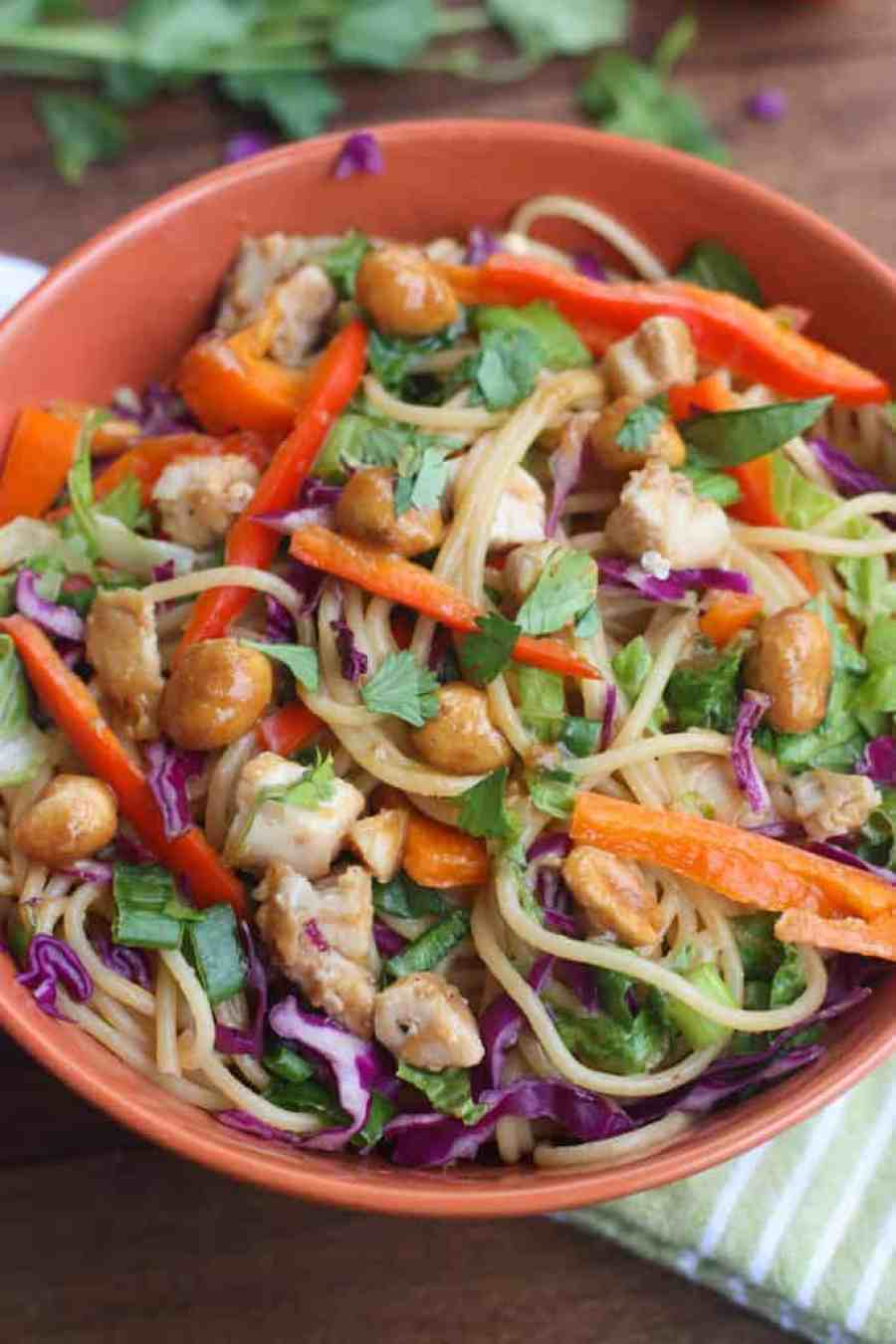 Better than takeout Thai Peanut Chicken Pasta - The perfect easy dinner recipe that's bursting with flavor and uses simple pantry ingredients with sautéed veggies, chicken and a creamy thai peanut sauce. | Tastes Better From Scratch