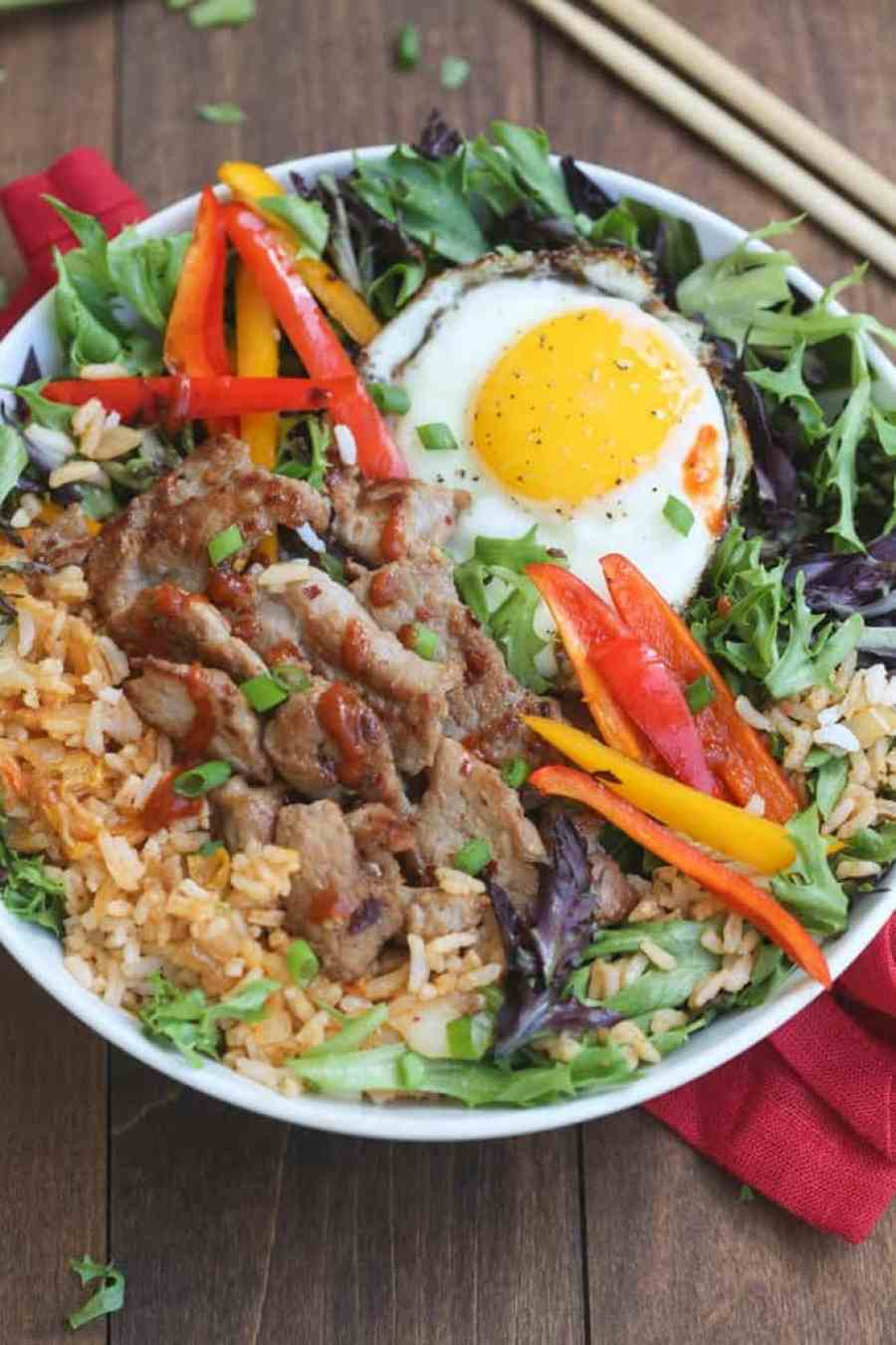 Korean Bulgogi Bowls   simple marinated bulgogi pork served over kimchi fried rice and leafy greens with a fried egg on top. Packed with flavor, these bowls are AMAZING!   Tastes Better From Scratch