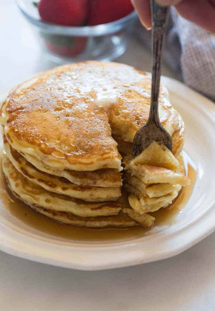 There's nothing yummier than a big delicious stack of homemade buttermilk pancakes! | tastesbetterfromscratch.com
