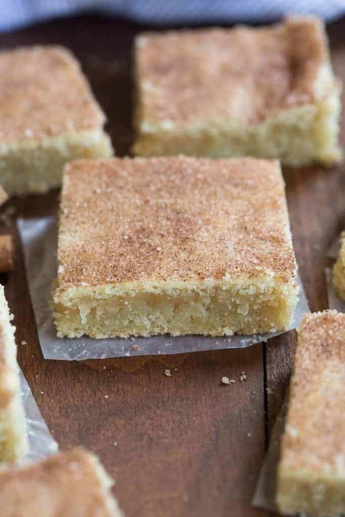 These snickerdoodle bars are AMAZING! I love snickerdoodle cookies but these bars are even easier to make. No rolling or chilling the dough. I could eat the entire pan! The best easy cookie bar recipe! | tastesbetterfromscratch.com