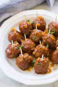 Hawaiian BBQ Meatballs are the perfect fun, easy party appetizer! You can make them in the slow cooker or on the stovetop. | tastesbetterfromscratch.com
