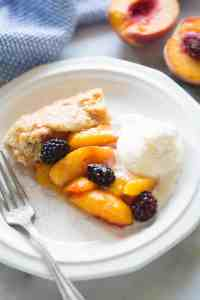 A delicious slice of Peach Blackberry Tart! This dessert couldn't be easier to make. The perfect dessert for using fresh peaches.   tastesbetterfromscratch.com
