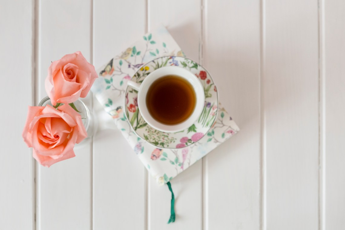 tea cup, book, and flowers