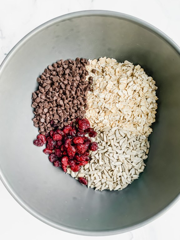 oats, chocolate chips, seeds and dried fruit in a bowl