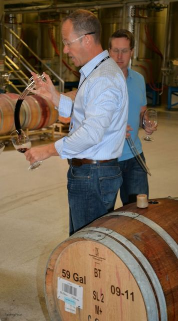 Raymon McKee sampling barrels of Merlot from Chateau Ste. Michelle Horse Heaven Hills fruit