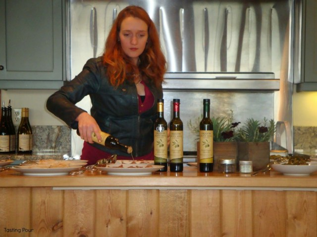Libby Clow drizzles olive oil at a guided olive oil tasting and pairing at Oregon Olive Mill at Red Ridge Farms