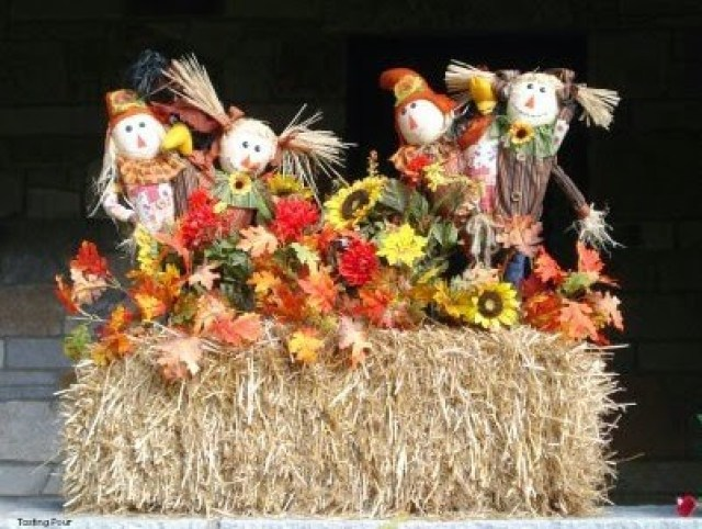 Fun scarecrow hay bale sunflower harvest decoration