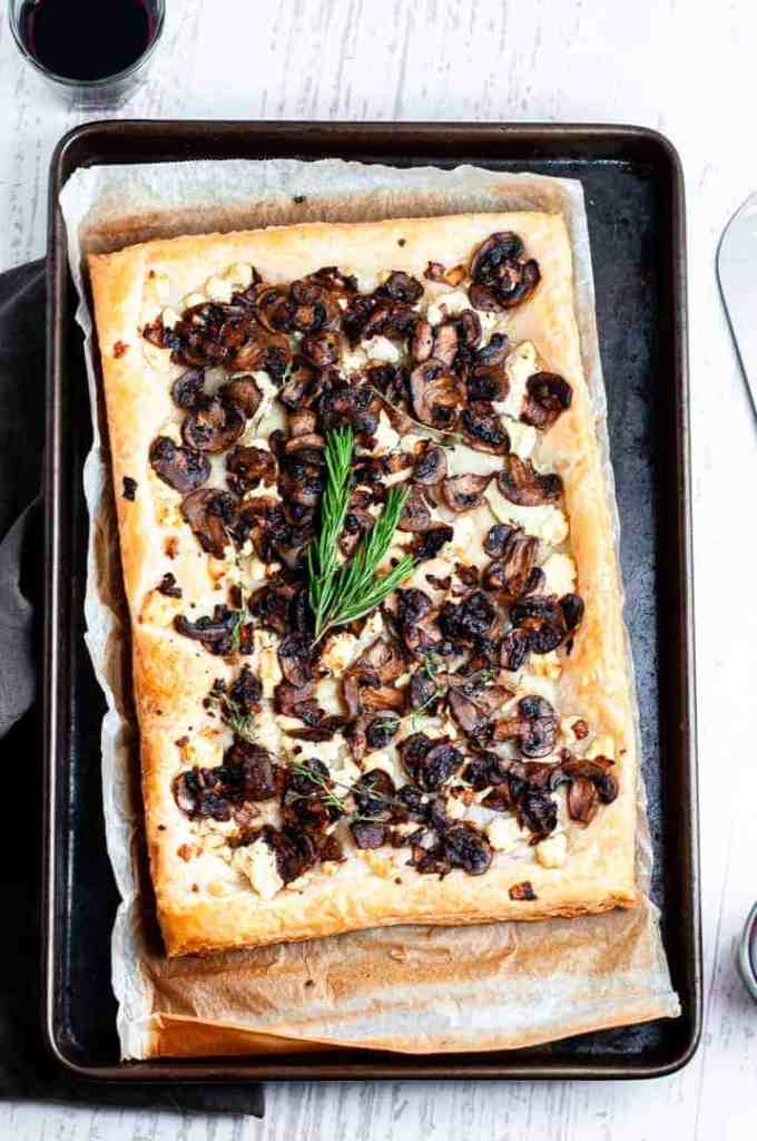 Mushroom and goat cheese tart on a baking tray