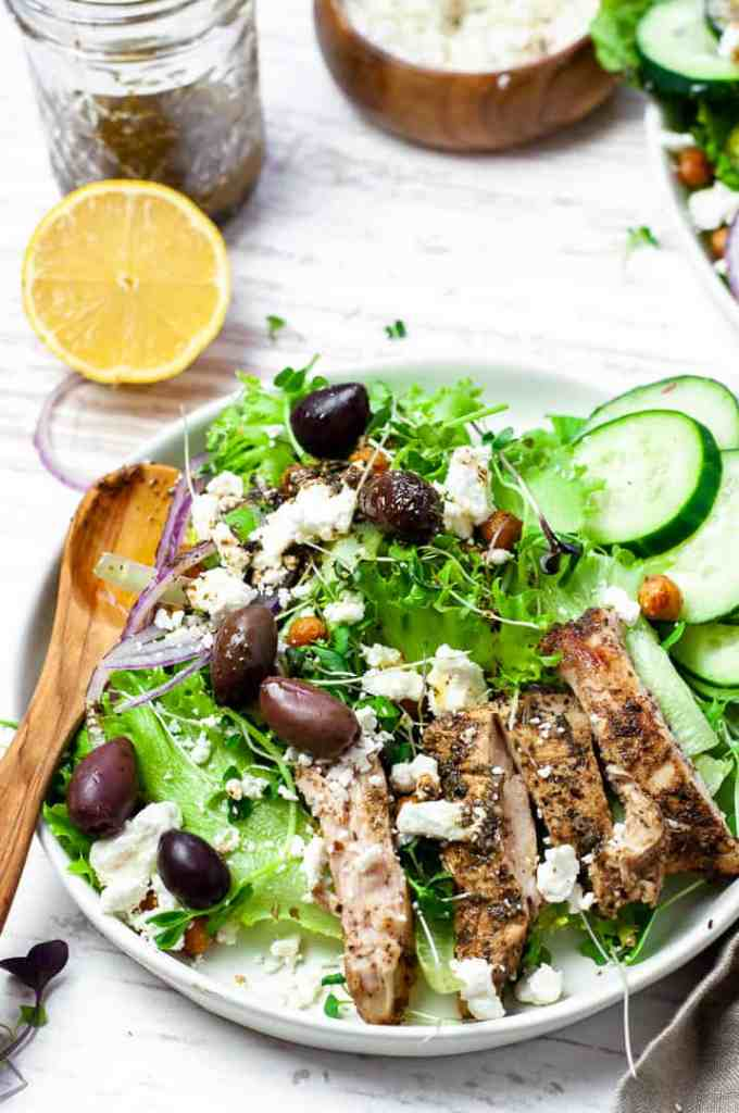 Greek chicken salad with crispy chickpeas in a bowl