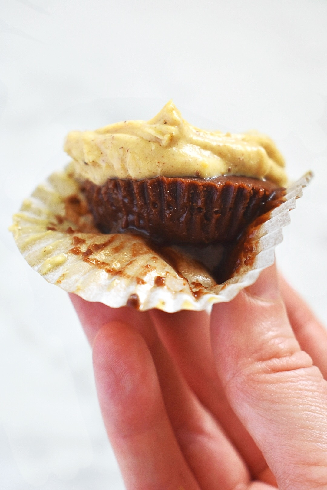 vegan pumpkin fudge cup with spiced cream cheese frosting