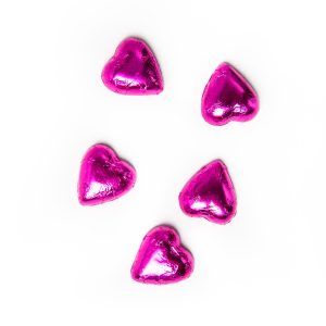 5 pink foil wrapped milk chocolate hearts.