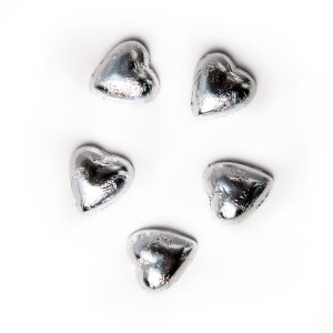 5 silver foil wrapped milk chocolate hearts.