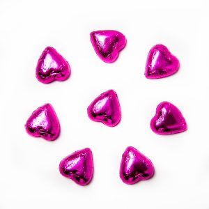 8 pink foil wrapped milk chocolate hearts.