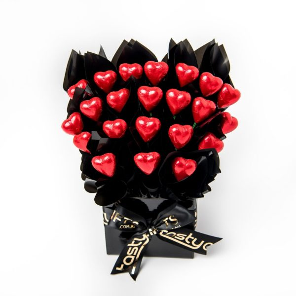 22 red foil wrapped milk chocolate hearts surrounded by black cello in a small black box.