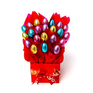 22 Milk chocolate half eggs surrounded by red cello in a small red box.