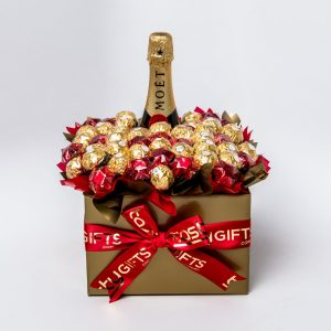 A 750ml Moët & Chandon Brut Impérial Champagne NV, 32 Ferrero Rocher chocolates and 20 red foil wrapped milk chocolate stars surrounded by red and gold cello in a large gold box