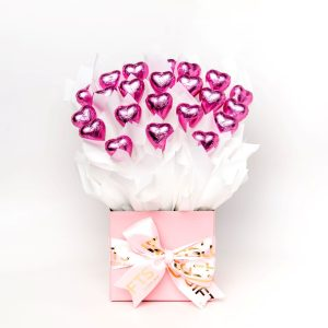 22 pink foil wrapped milk chocolate hearts surrounded by white cello in a small baby pink box.
