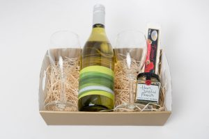 This hamper consists of the following: 1 x 750ml Stony Peak Semillon Sauvignon Blanc 2 x Wine glasses 1 x 60g Ogilvie & Co. roasted nuts 1 x 60g Flying Swan nougat
