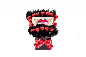 """A 100g Bloomsberry """"Boss Mum"""" chocolate bar and 16 red foil wrapped milk chocolate hearts surrounded by black cello in a small black box. Finished with a red ribbon with silver print."""