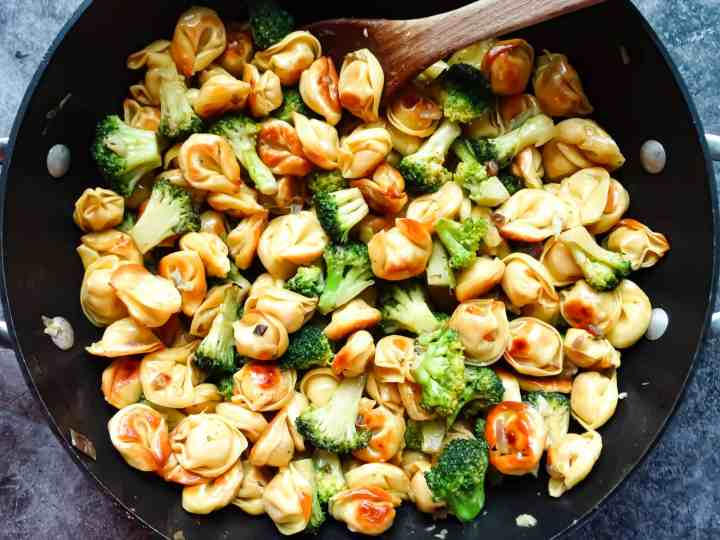 pan fried tortellini and broccoli in a wok