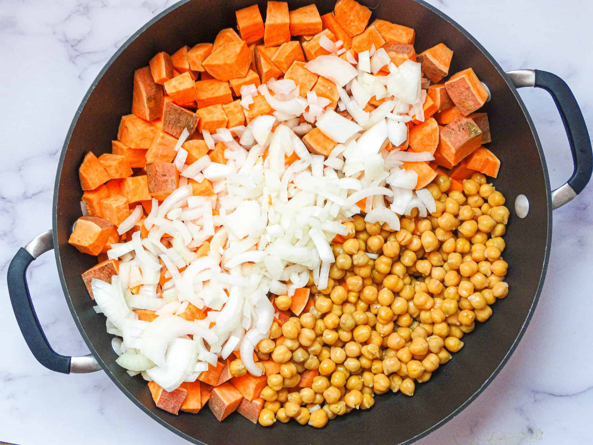 sweet potato chickpea onion in a large pan