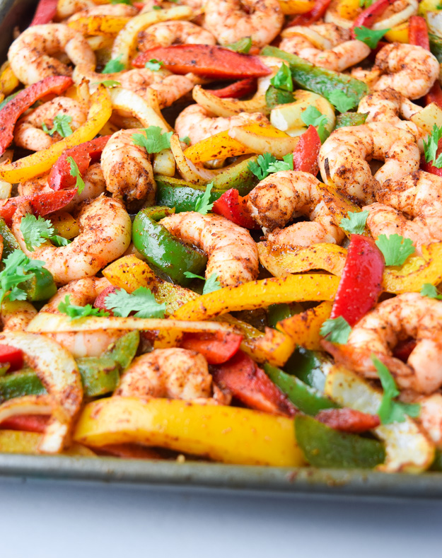 Sheet Pan Shrimp Fajitas (Paleo Whole30) - a delicious and easy dinner ready in under 15 minutes. Tasty, healthy, and family-friendly! | tastythin.com