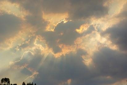 Sun through smoke tinged clouds.