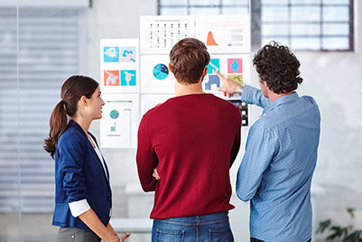 people in front of chart working creative process