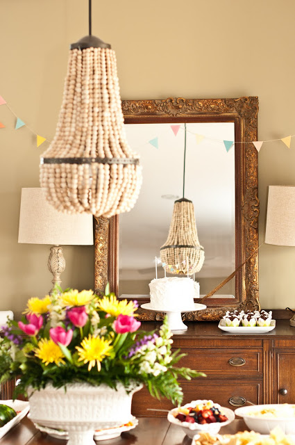 Upcycle a plain chandelier into a beaded showpiece natural wood bead chandelier aloadofball Image collections