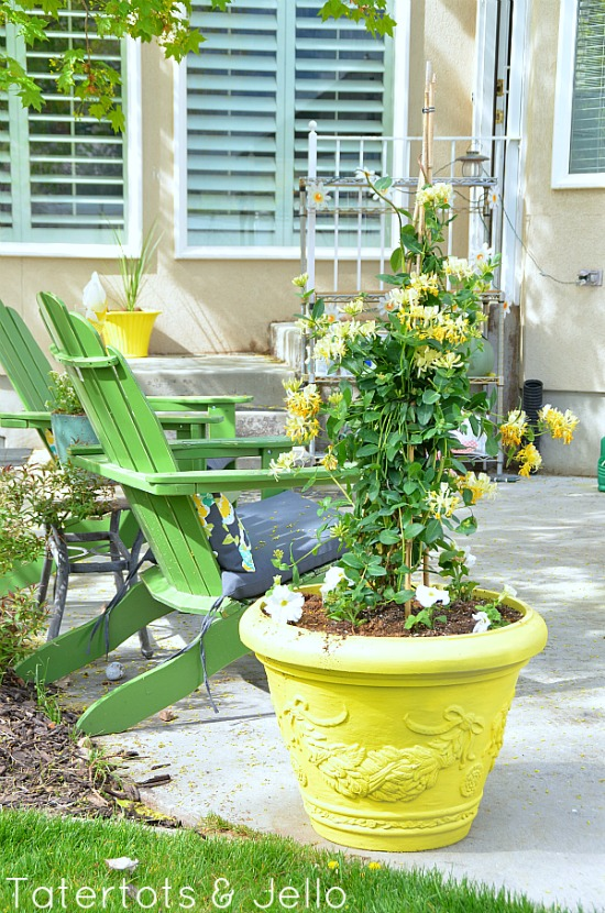 painted yellow pots at tatertotsandjello.com