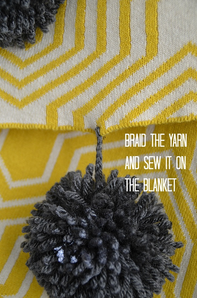 braid the yarn and sew it on the blanket
