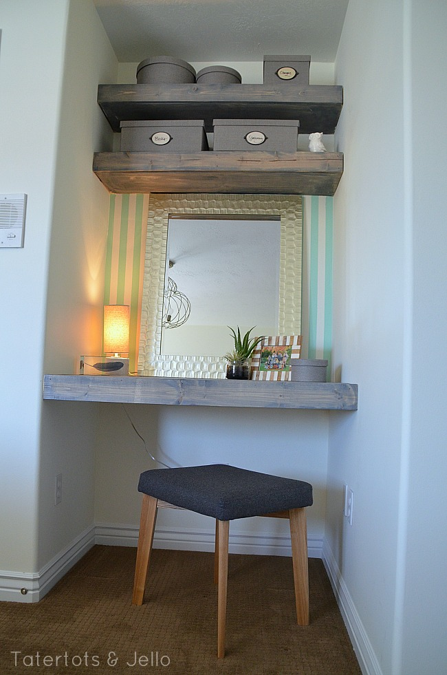 floating desk and shelves in a guest room