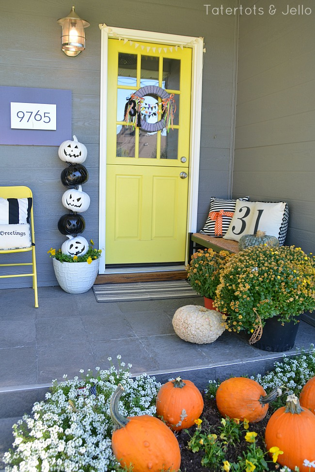 Spray paint foam jack-o-lanterns and stack them to create a Halloween Topiary. Add lights and you have a super cute and festive way to welcome guests to your home!
