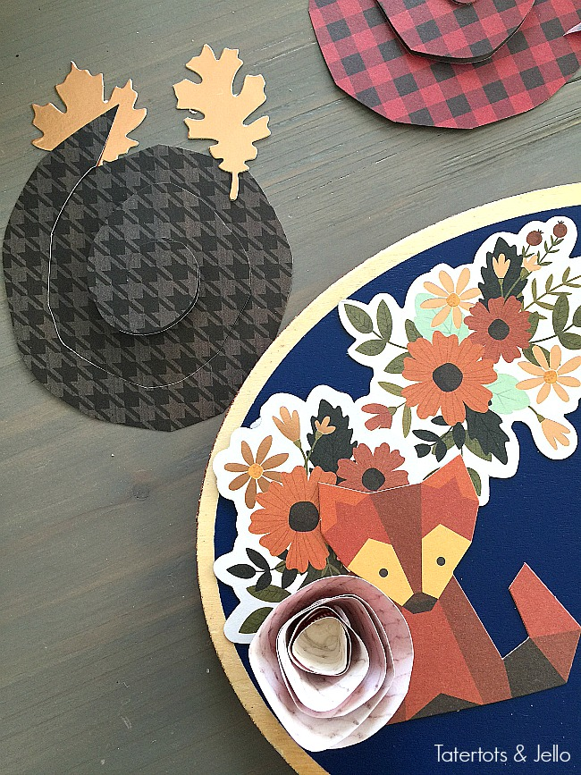 make-easy-paper-flowers. Easy Thanksgiving Door Hanging. Make a Door Hanging with an inexpensive wood slice, paper and embellishments. Find out how easy it is to make and how to make rolled paper flowers!