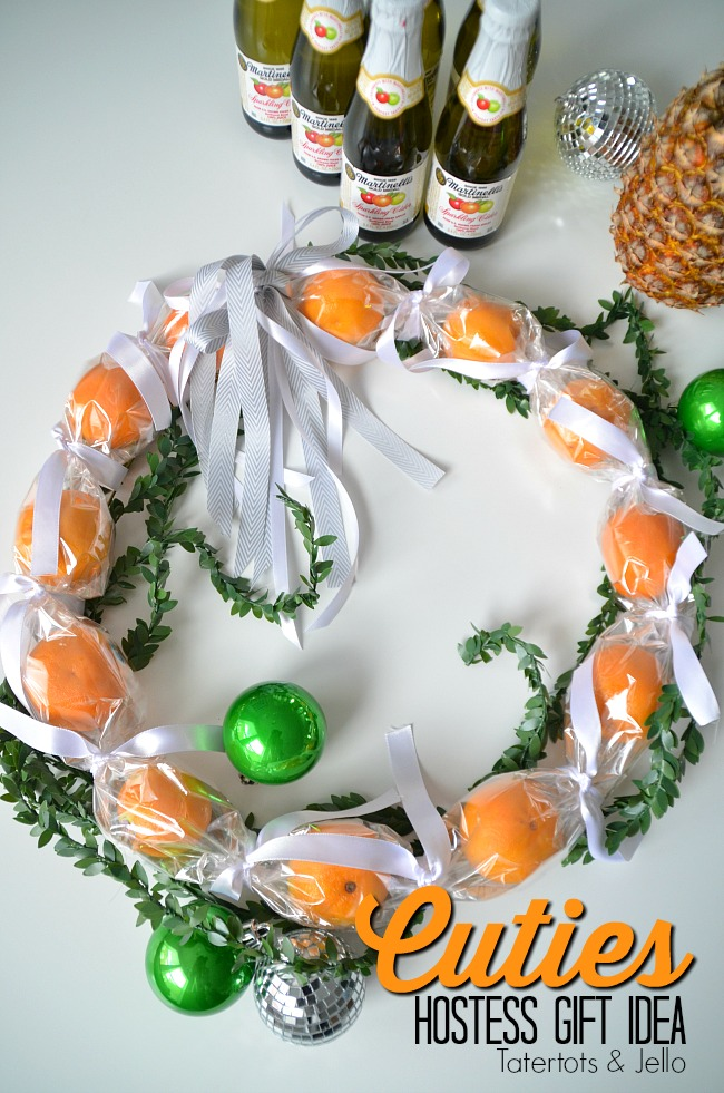 Cuties Wreath Hostess Gift Idea. Use cellophane to create a cuties wreath. It's edible and perfect to give as a neighbor or hostess gift this holiday season!