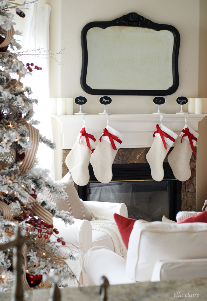simple and beautiful red and white mantel with stockings and bows