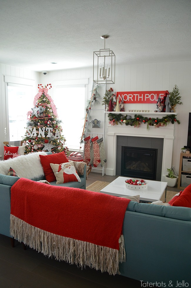 Santa North Pole Christmas Tree decorating ideas. Make a simple red and white Santa christmas tree. Find all the details and DIY ideas at Tatertots and Jello!