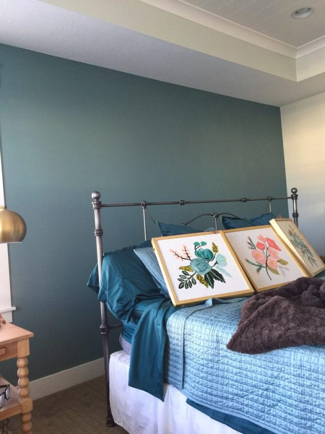 Painting a focal wall can take the stress out of adding a bright or dark paint color to a room.